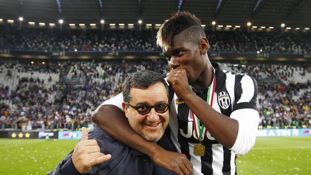 Paul Pogba con il suo agente, Mino Raiola.